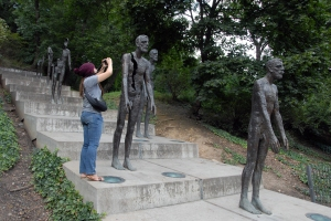 First stop on the Dissident Tour finds leader Anna Hoffman finding all the good angles to tell about the Memorial to the Victims of Communism.