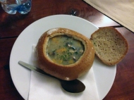 Tucked in behind the wall of a courtyard, we found an authentic spot on a cool and rainy night, just right for vegetable soup in a rye bread bowl.