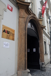 The imposing front door of AAU looks out on a busy street with trams.