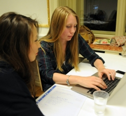 Assel Biyeva from Kazakhstan and Kristina Zakurdaeva from Czech Republic discuss a hypothetical editorial and what information they would need to write it well. Both are seniors in journalism at Anglo-American University in Prague.
