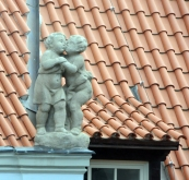 This little couple adorns the roof near my office window.