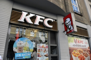 "Right in the middle of Wenceslas Square, Prague's best known shopping district, the Colonel smiles down and promises not only fried chicken but ""4 světové chutě"" (world flavors)."