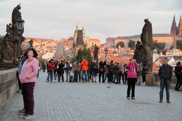 6:15 a.m. and Charles Bridge is full of tourists, waiting for the sun to creep over the buildings of Old Town. One must have been a tour group there for that very purpose, and they almost made a better image than the rising sun did.